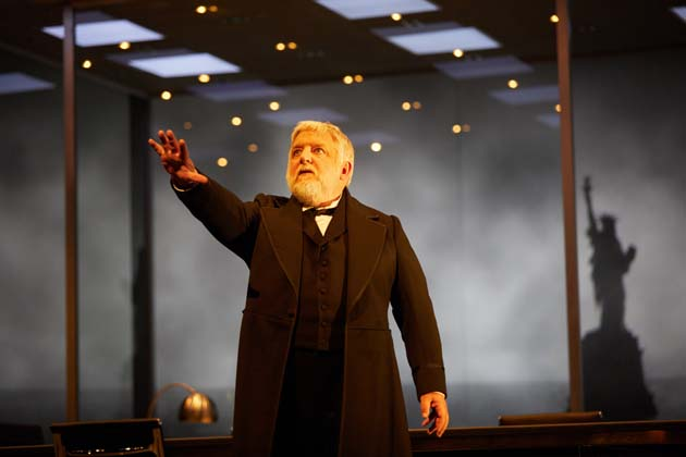 Simon Russell Beale in The Lehman Trilogy at the National TheatreA co-production with Neal Street Productionsby Stefano Massiniadapted by Ben Power Production teamDirectorSam MendesSet DesignerEs DevlinCostume DesignerKatrina LindsayVideo DesignerLuke HallsLighting DesignerJon ClarkMusic and SoundNick PowellMovementPolly Bennett Photo by Mark Douet