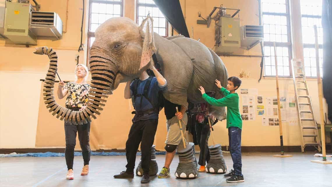 Joshua Fernandes with Oona the Elephant. Photo Johan Persson | First Look: Running Wild in rehearsal