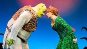 2015 Original UK Tour Company. Dean Chisnall (Shrek) and Bronté Barbé (Princess Fiona). Credit Helen Maybanks
