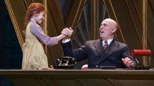 Ruby Stokes (Annie) and Alex Bourne (Daddy Warbucks) in Annie at the Piccadilly Theatre
