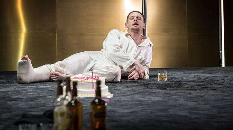 Jack O'Connell (Brick) in bed scene of Cat on a Hot Tin Roof at Apollo Theatre, London