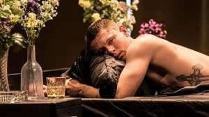 Jack O'Connell (Brick) shirtless in Cat on a Hot Tin Roof at Apollo Theatre, London